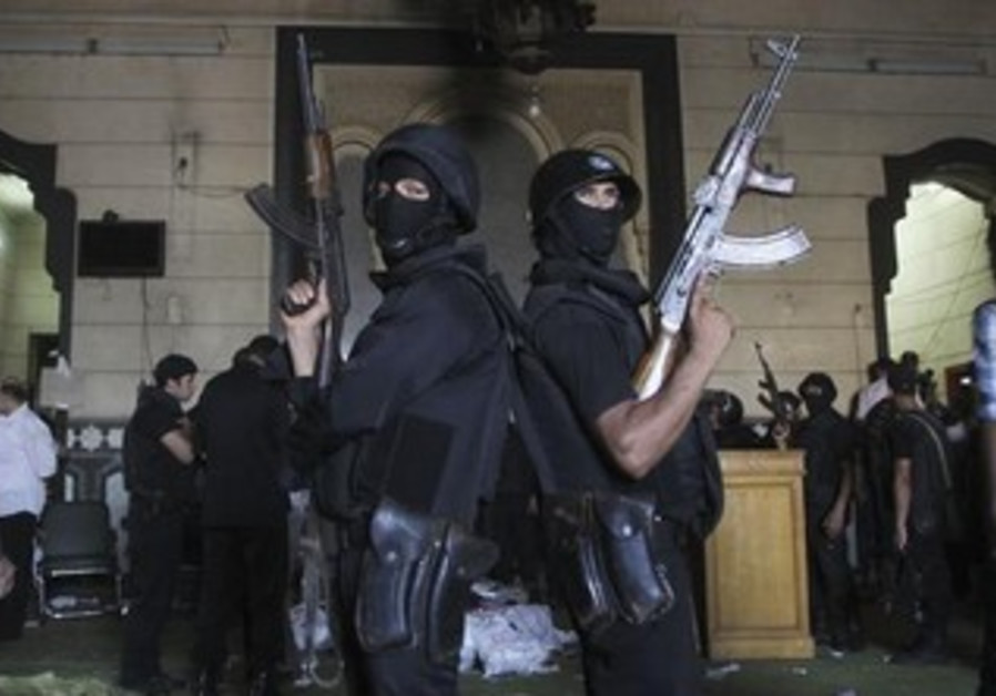 Policemen stand guard inside a room of the al-Fath mosque.