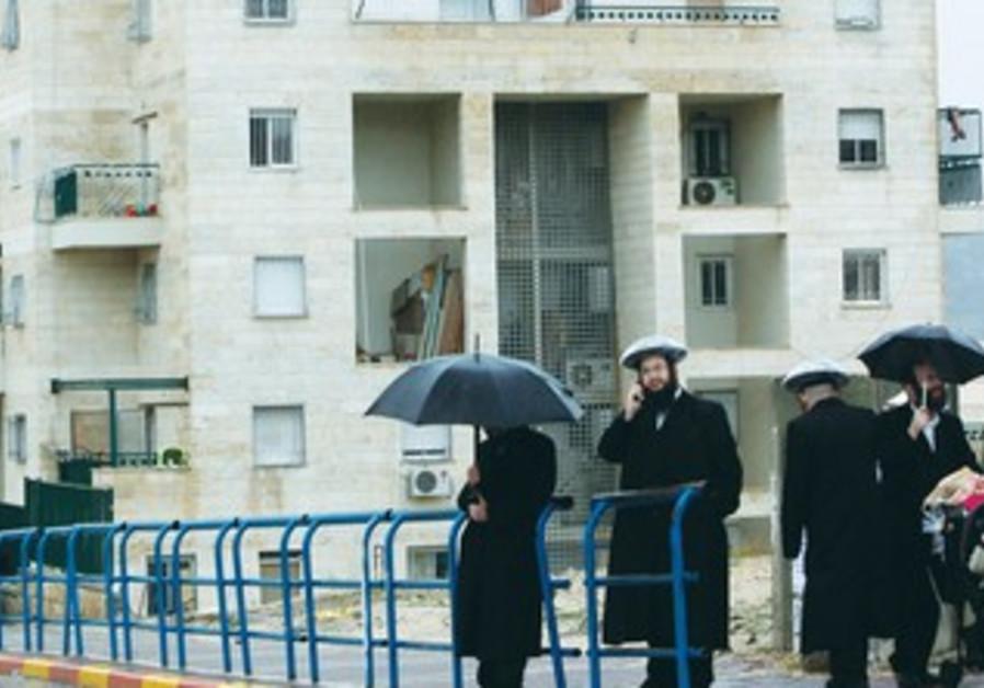 HAREDIM STAND on a sidewalk in Ramat Beit Shemesh
