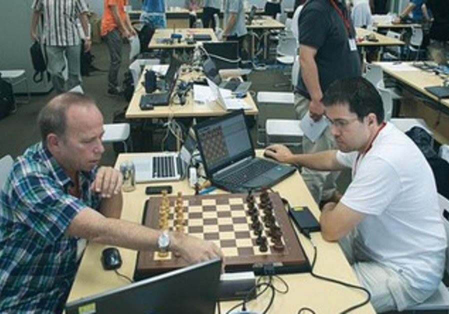 A PAIR of computerized opponents play a game at the world computer chess championships in Yokohama,