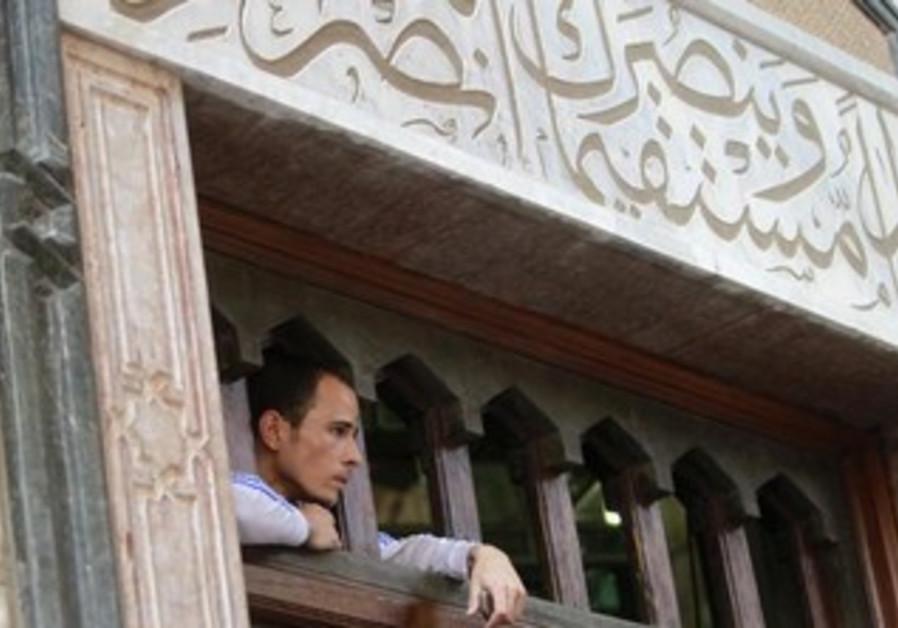 A supporter of Mohamed Morsi looks on in Cairo