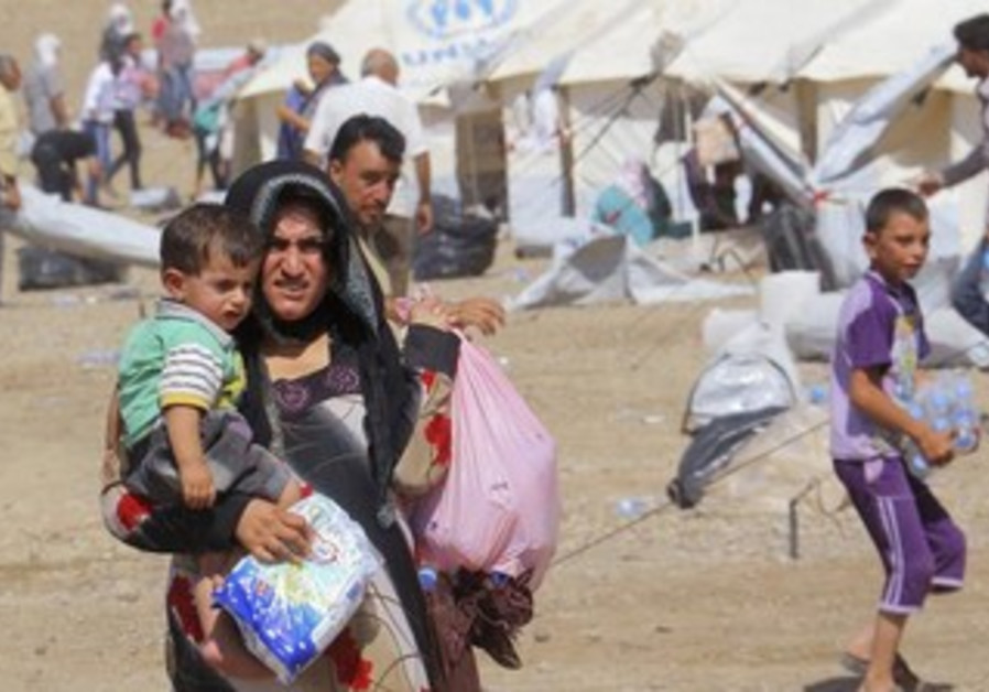 Syrian refugees at refugee camp in Arbil, about 350 km north of Baghdad August 16, 2013.