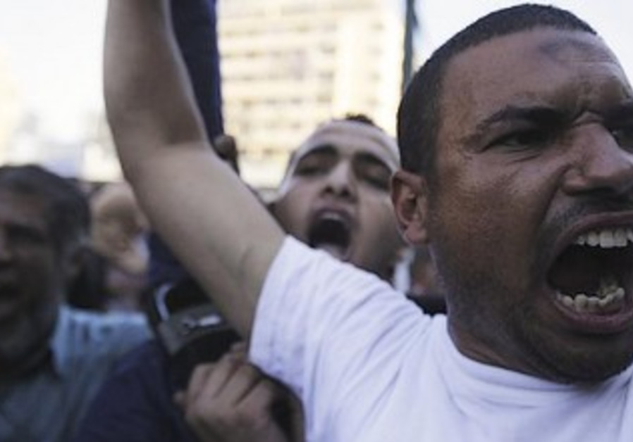 Muslim Brotherhood supporters protest in Giza Square, south of Cairo, August 18, 2013.