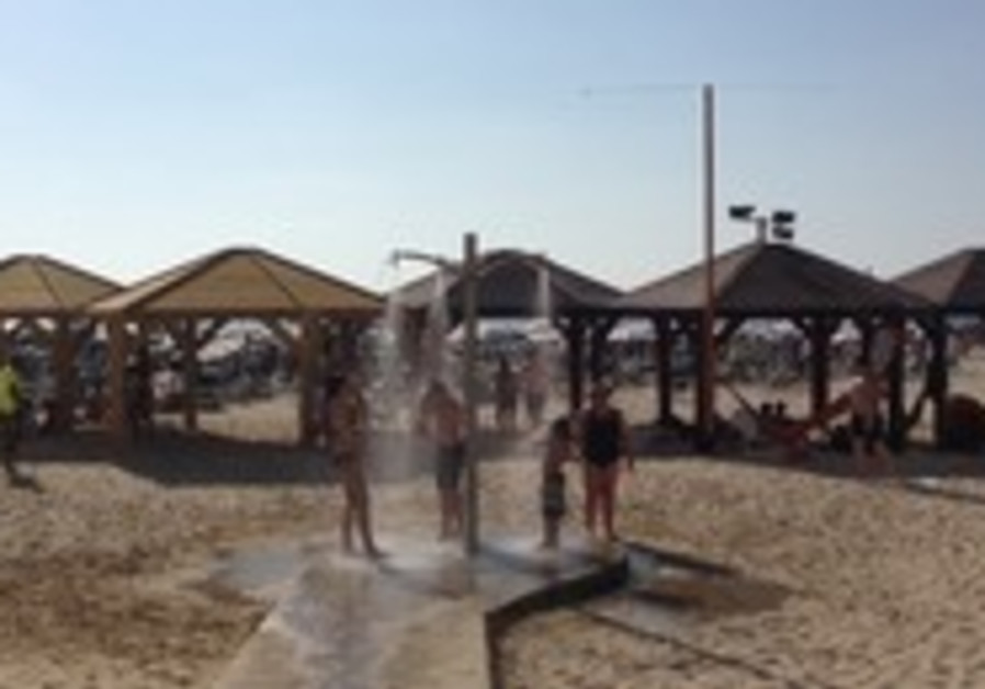 Tourists cool off at Tel Aviv beach