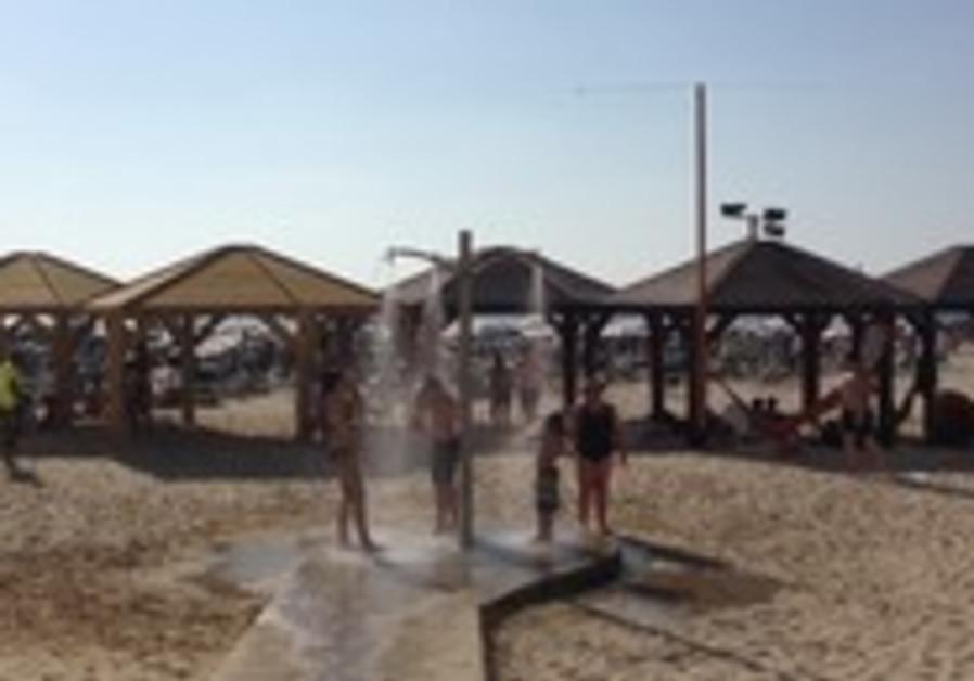 Tourists cool off at Tel Aviv beach