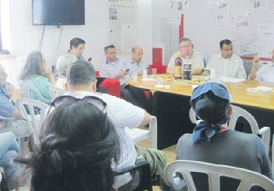 MOSHE LION (right), the Jerusalem mayoral candidate, addresses 'The Jerusalem Post' staff on Monday.