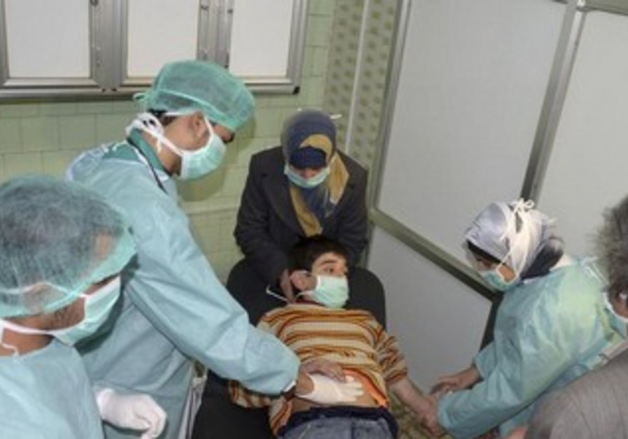 Boy affected by alleged chemical weapons attack in Syria [file]