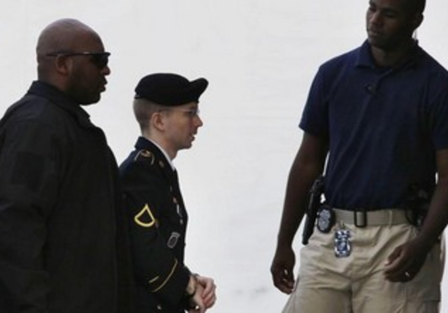 Bradley Manning is lead to court on August 21, 2013.