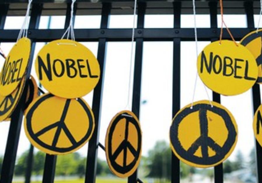 PEACE SYMBOLS adorn a fence.