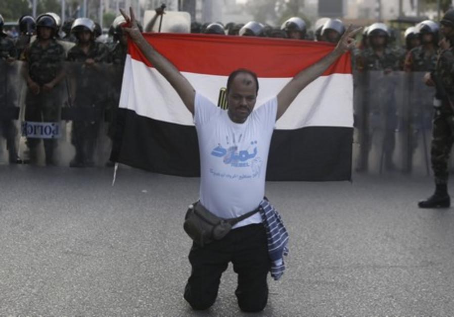 "A member of the ""Tamarod - Rebel!"" petition drive"