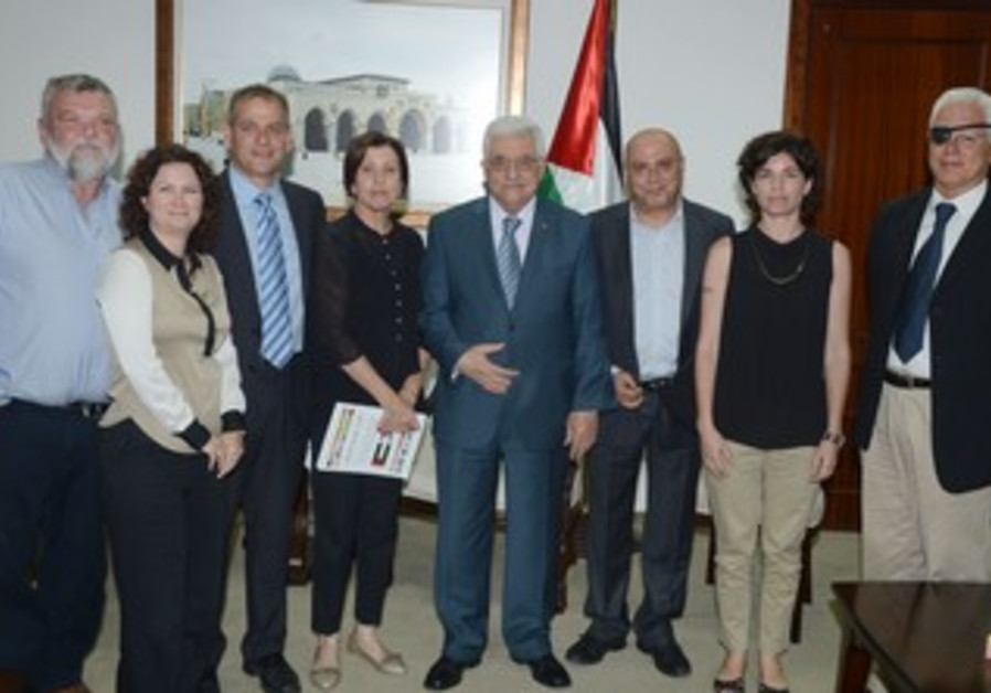 Mahmoud Abbas with a visiting group of Meretz MKs in Ramallah, August 22, 2013.