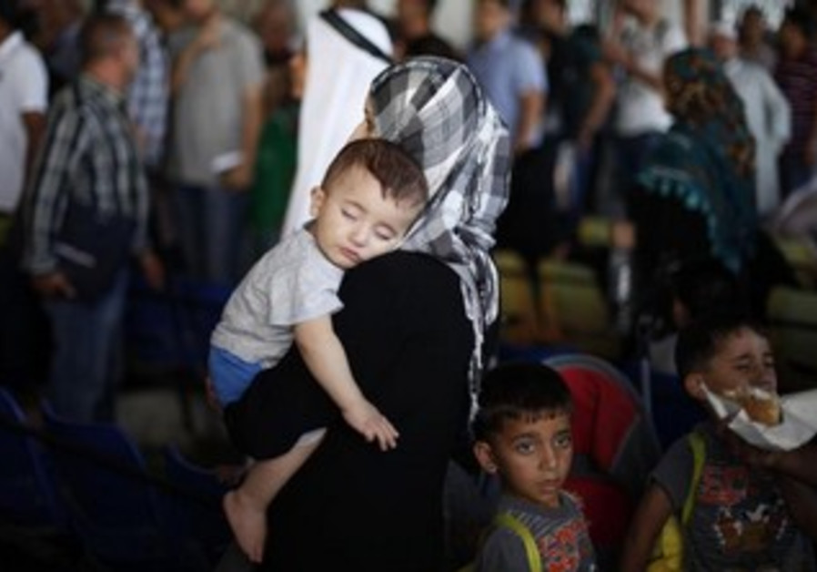Palestinians in Rafah wait to cross into Egypt
