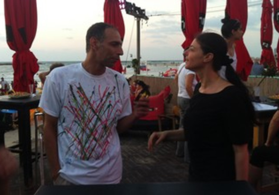 Labor MK Merav Michaeli speaks to a supporter at a pre-Rosh Hashanna event on the Tel Aviv shore.