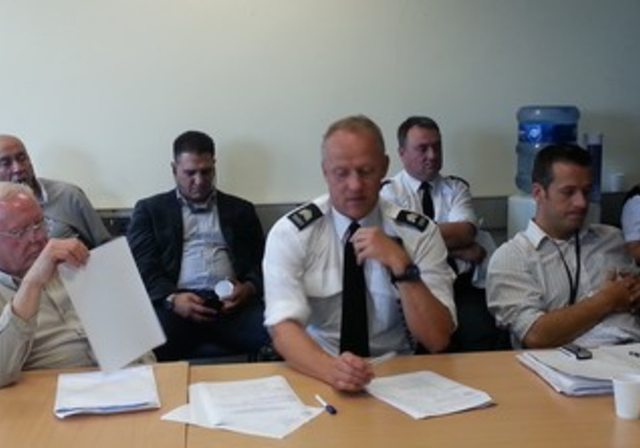 Leaders watch work of local civilian 'Advisory Committee' to a N. Ireland police station commander