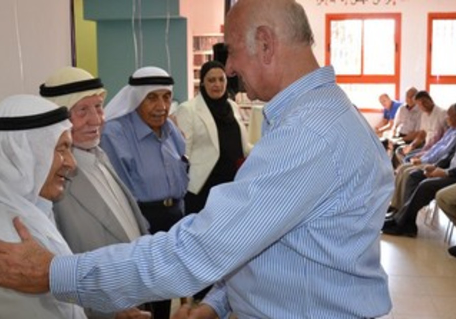 Minister Yaakov Peri with Baka al-Gharbia residents.