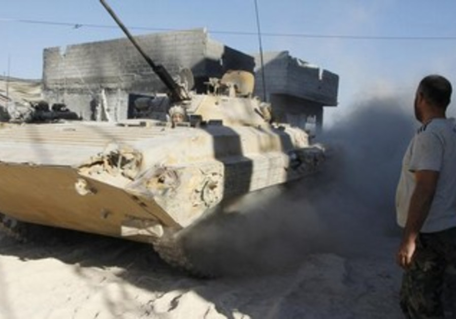 A Syrian army tank in action.