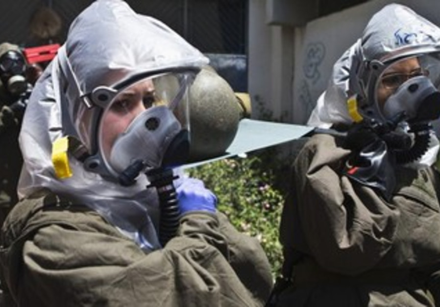 Israeli soldiers evacuate a mock victim during a drill simulating a chemical attack May, 2013.