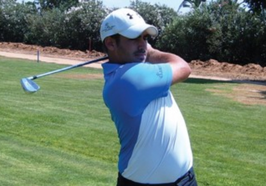 TOMER KOREN shoots from the fairway at the Ga'ash Golf Club, where he claimed another victory.