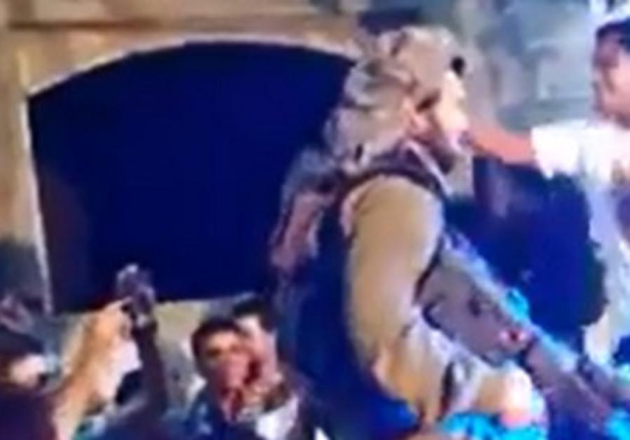 Screencap of Israeli soldier dancing with Palestinians in Hebron