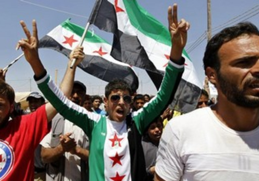 A protestor shouts slogans at rally against the proposed attack on Syria in London Aug 29, 2013