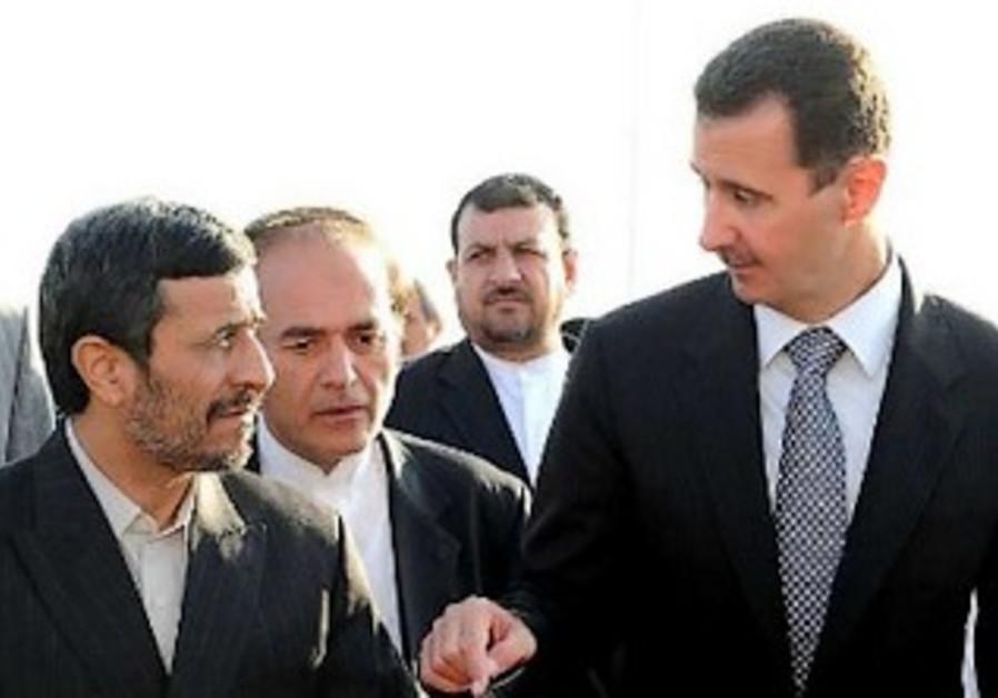 Former Iranian President Mahmoud Ahmadinejad and Bashar Assad in Damascus in September 2010.