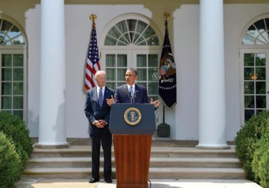 Barack Obama et Joe Biden devant la Maison Blanche: les Etats-Unis attendent le feu vert du Congrès.