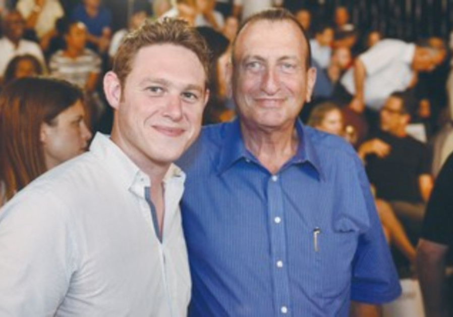JONATHAN JAVOR (left) poses for a photo with Tel Aviv Mayor Ron Huldai in the White City recently.