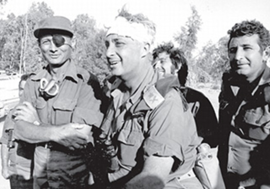 Defense Min.  Moshe Dayan and Gen. Ariel Sharon on the banks of the Suez during the war, Oct. 1973.