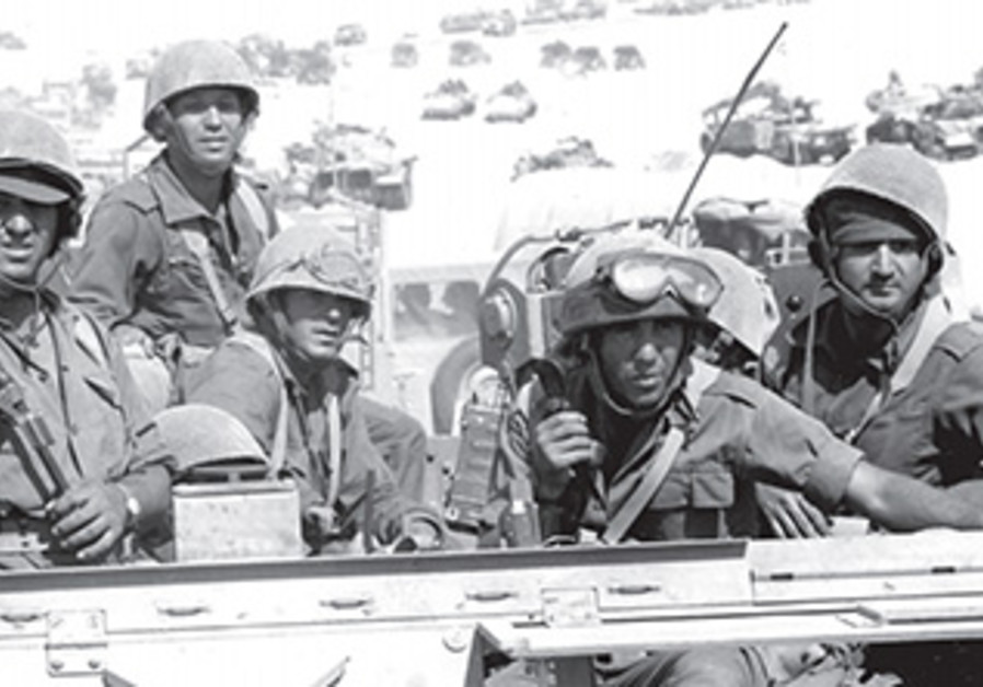 IDF soldiers move through the Sinai toward the Suez Canal during the Yom Kippur War.