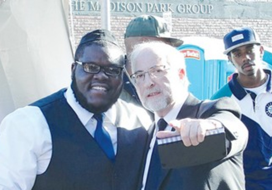 Nissim (left), formerly known in Seattle rap circles as D. Black, with Rabbi Simon Benzaquen