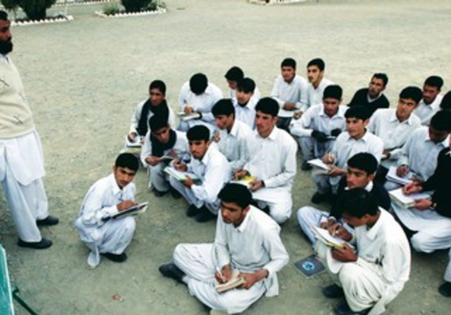 STUDENTS ATTEND a class in South Waziristan
