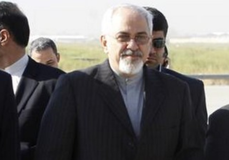 Iran's Foreign Minister Mohammad Javad Zarif (C) arrives at Baghdad International Airport Sept. 8