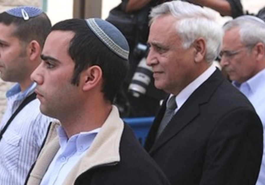 Moshe Katsav leaves the Supreme Court after it upheld his rape conviction, November 2011.