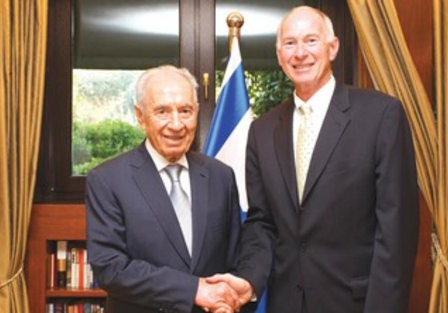 PRESIDENT SHIMON PERES meets with Merck representative Dr. Michael Rosenblatt