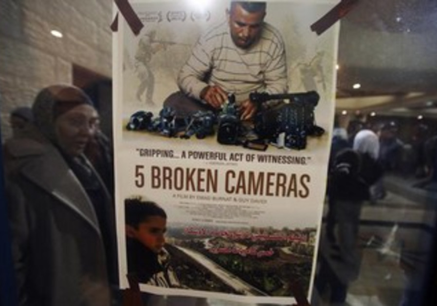 "A poster for the Oscar-nominated documentary ""5 Broken Cameras."""