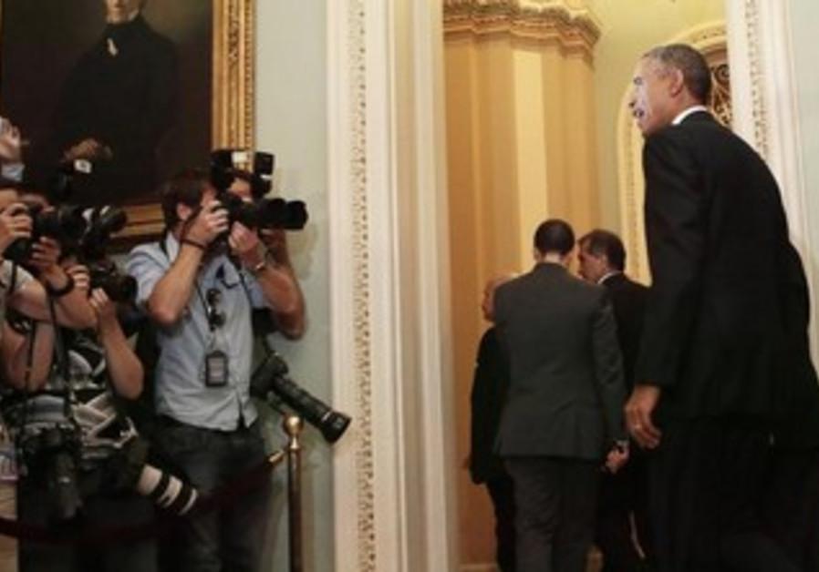 U.S. President Barack Obama leaves a luncheon meeting with Senate Democrats in Washington