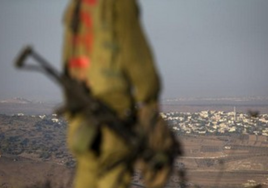 An Israeli soldier on the Golan Heights near Syria border