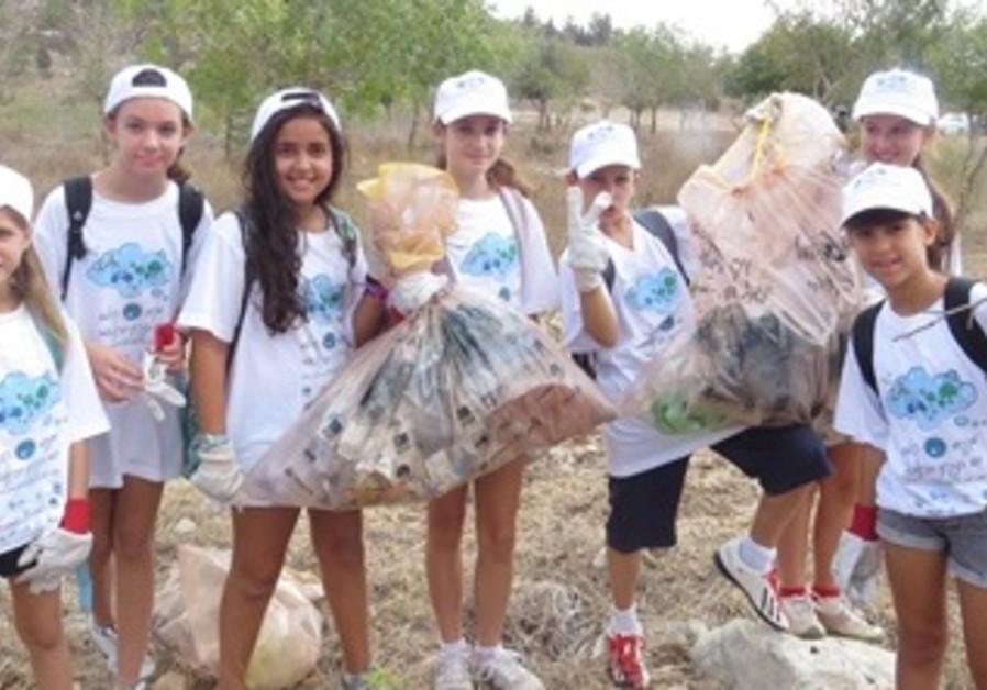Children Help Clean Up the World in Ben Shemen Forest