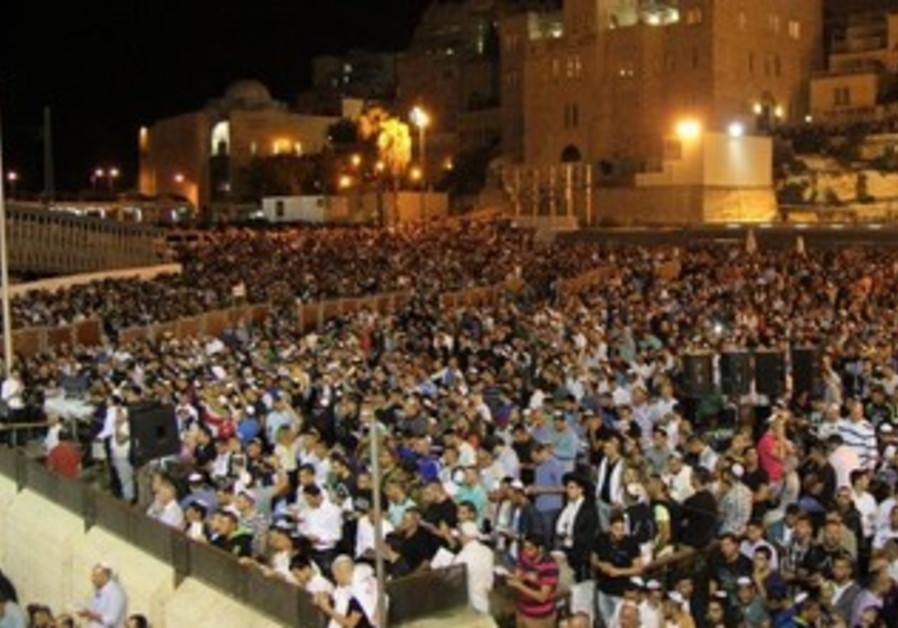 Jews praying at the Western Wall.