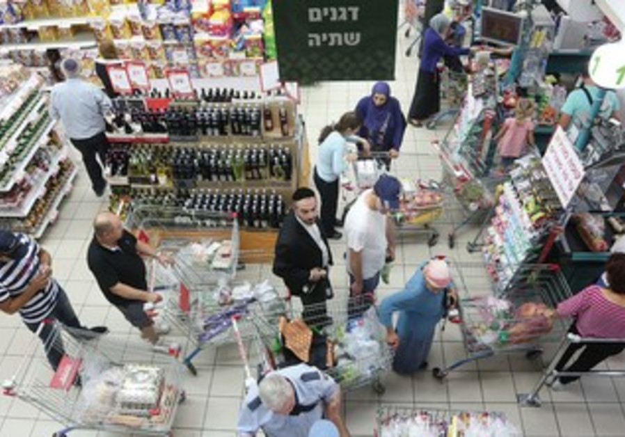 ISRAELIS SHOP at a Jerusalem supermarket. Overall, we're happy with our lot.