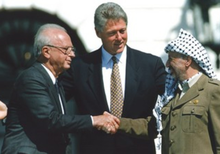 The signing of the Israeli-PLO peace accord at the White House in September 1993.