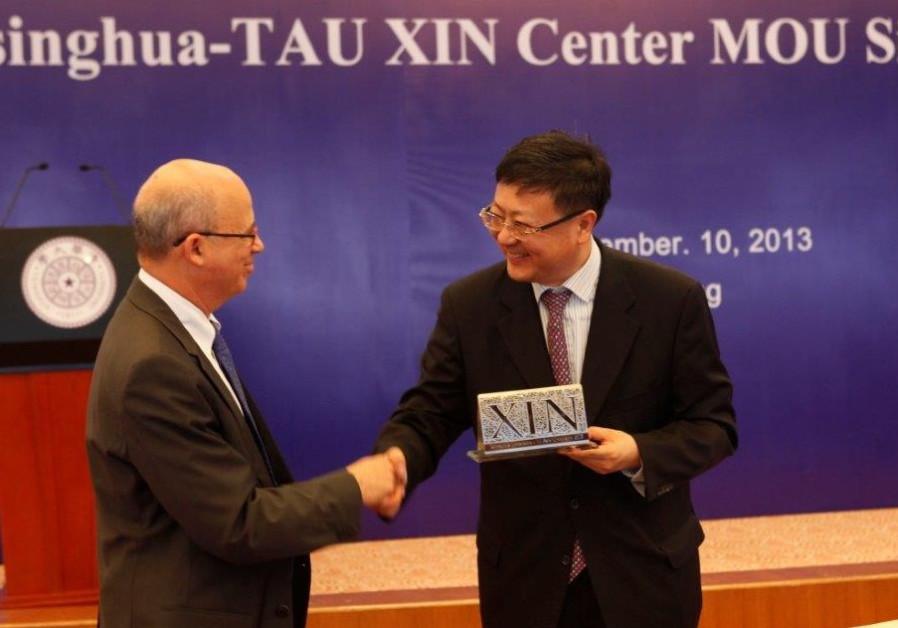 TAU president Prof Klafter and Tsinghua University president Prof Jining.