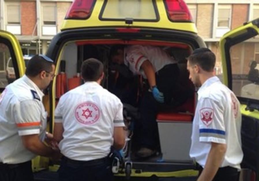 MDA paramedics evacuating woman to hospital in Jerusalem.