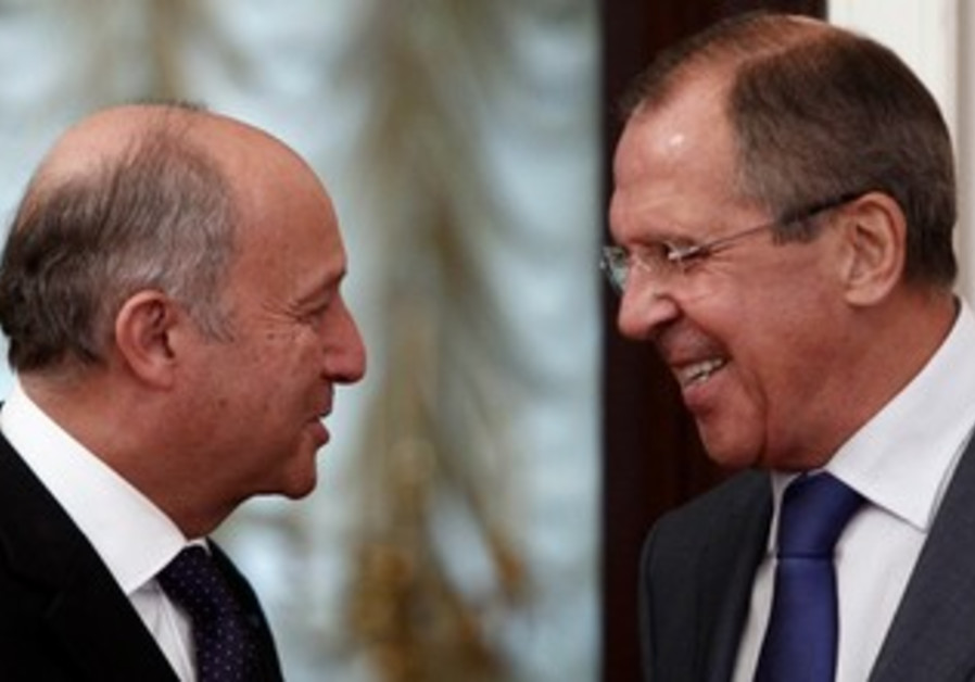 Russian FM Sergei Lavrov andf French FM Laurent Fabius meet in Moscow, Sept. 17, 2013.