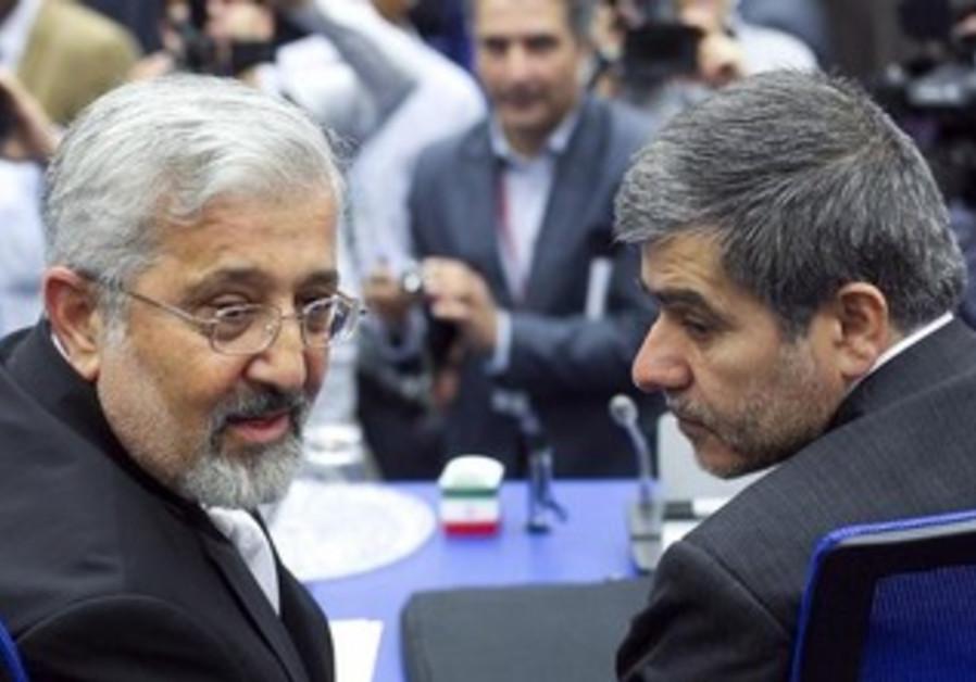 Iran's Head of Atomic Energy Organization Fereydoon Abbasi-Davani (R) and ambassador to IAEA