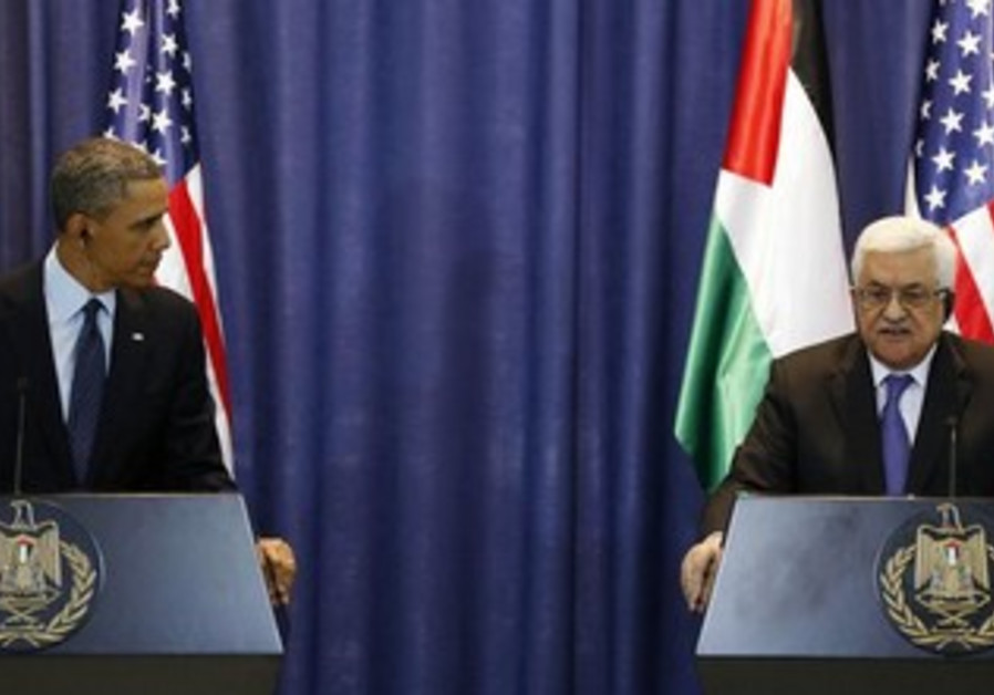 US President Barack Obama and PA President Mahmoud Abbas in Ramallah March 21, 2013.