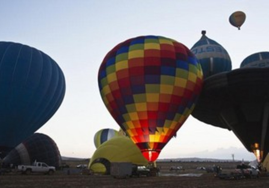 Hot air balloons are prepared during 2-day festival near Mount Gilboa