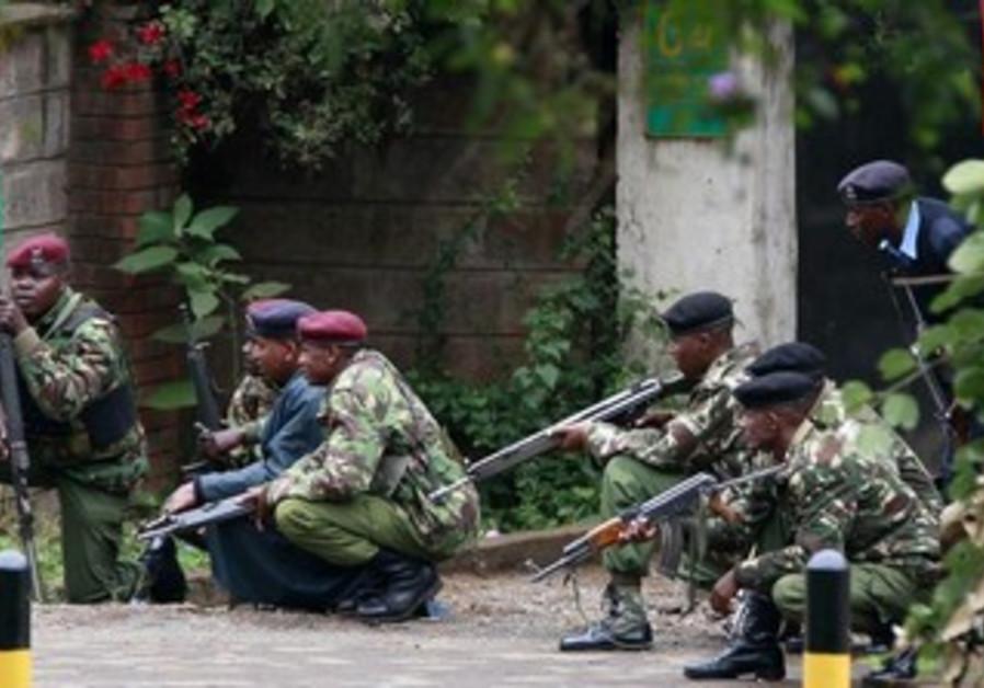 Kenyan police officers take position in the capital Nairobi, September 23, 2013.