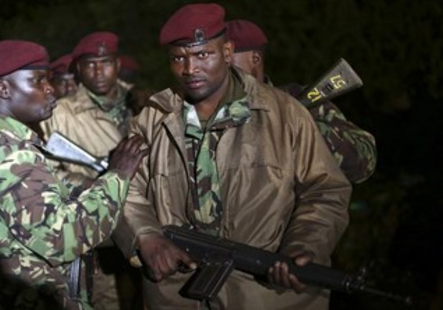 Kenyan soldiers hold their rifles near the Westgate shopping centre in Nairobi September 23, 2013.