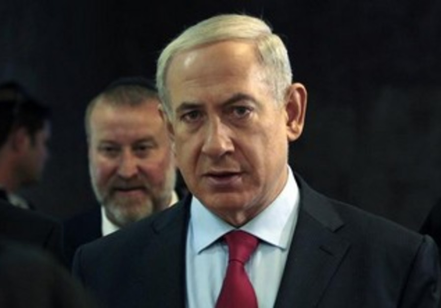 Prime Minister Binyamin Netanyahu arrives at the weekly cabinet meeting, September 17, 2013.