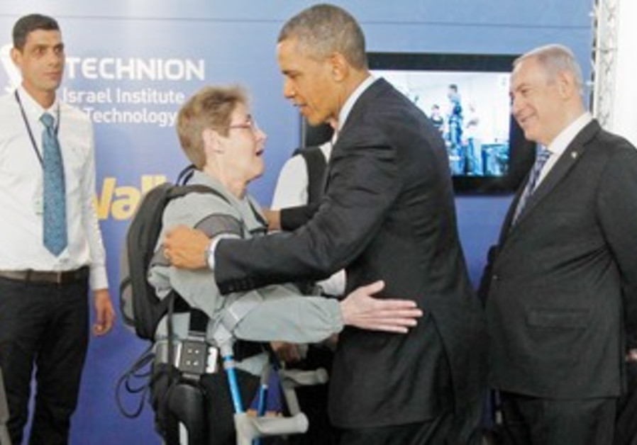 US President Barack Obama hugs paralyzed US Army Sgt. (res.) Theresa Hannigan during his March visit